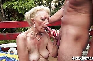 Mature Szuzanne plays with young cock