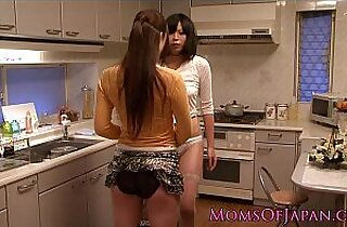 Japanese lesbian housewives licking and fingering pussy