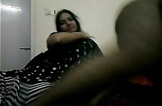 tamil bhabhi in black indian saree giving her hubby a blowjob on live show