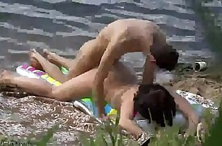 Young amateur couple making sex on the beach